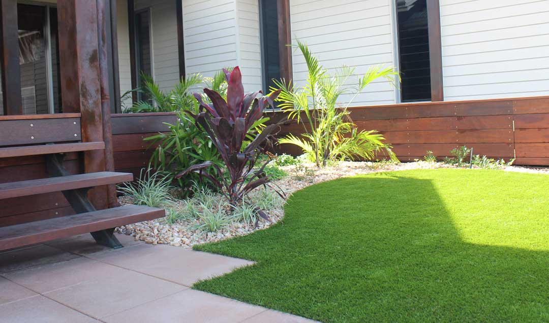 Airlie Beach Landscapers planting a new garden